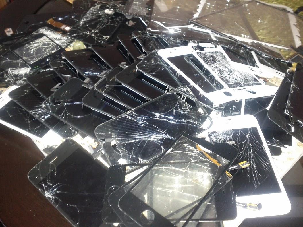pile-of-broken-iPhone-screens.jpg